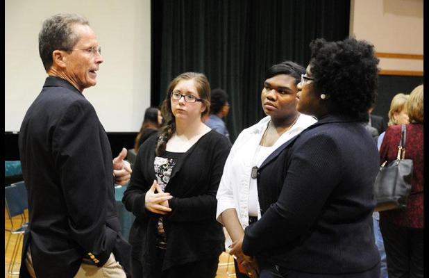 St. Mary Parish School Board President Mike Taylor engages in a conversation with West St. Mary High School students Mackenzie Daggett, Mackenzie Artis and Nya Bacon during a break at the New Generations Conference Wednesday night at Morgan City High School. Students from five St. Mary Parish high schools presented ideas ranging from lending a hand to ExploreLearning Gizmos.